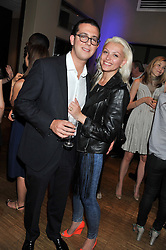 ANDREW RUBINS and CARINA POWOZOZKY at a party to celebrate the 10th anniversary of the restaurant Sumosan, Albemarle Street, London on 28th May 2012.