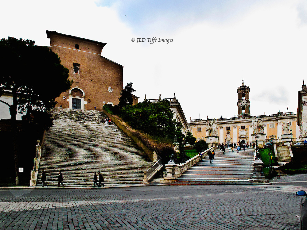 Rome, adjoining stairways of Santa Maria di  Ara Coeli and the Campidoglio hill seen from below, across the piazza by the Ara Coeli bus stop.