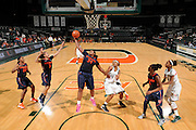February 20, 2014: Shakeya Leary #34 of Syracuse rebounds over Jassany Williams #21 of Miami during the NCAA basketball game between the Miami Hurricanes and the Syracuse Orange at the Bank United Center in Coral Gables, FL. The Orange defeated the Hurricanes 69-48.