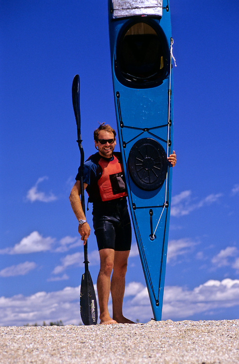 SEA KAYAKING, MAINE, paddler portrait w/ boat Marc Burgoin,