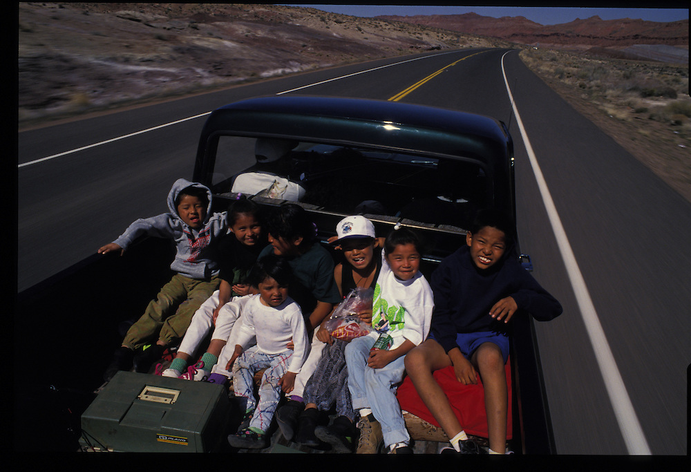 """""""We've got to have pickups,"""" tribal official Roman Bitsuie says.  """"Car just can't take"""" the rugged terrain of navajoland.  The 11 members of a Tuba City family crammed into this truck would surely agree."""