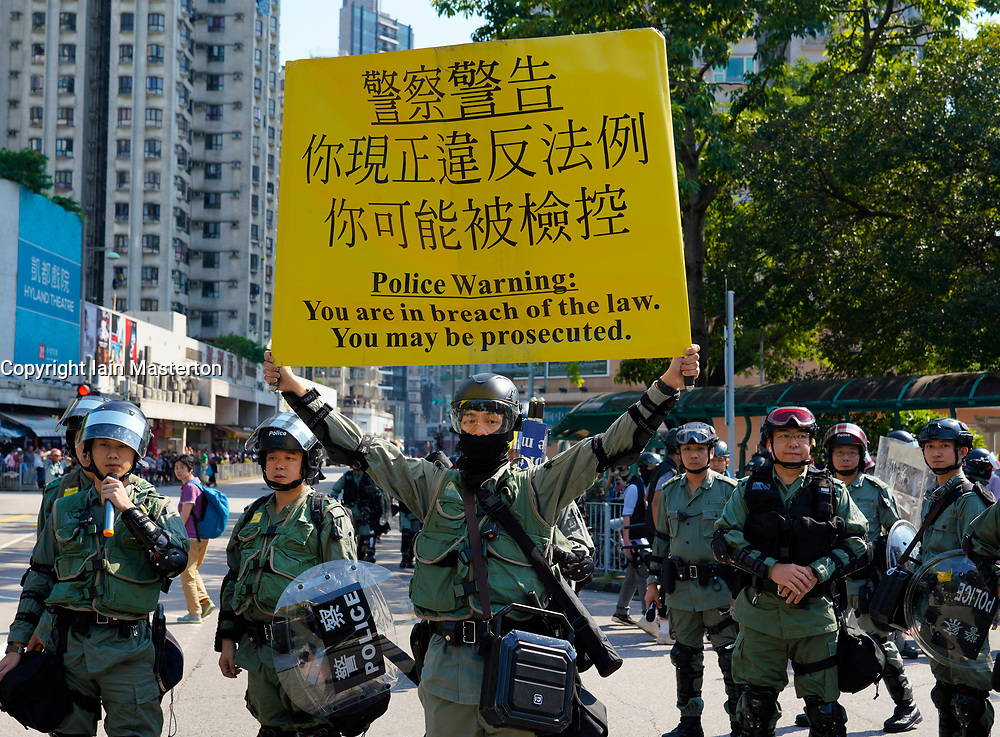 Tuen Mun, Hong Kong. 22 September 2019. Pro democracy demonstration and march through Tuen Mun in Hong Kong. Marchers protesting against harassment by sections of the pro Beijing community. Largely peaceful march had several violent incidents with police using teargas. Several arrests were made. Pictured; Police try to stop march. Iain Masterton Live News.