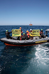 NORTH SEA MYAS 18JUN19 - Greenpeace activists in an inflatable boat display banners on day 10 of the BP rig protest in the North Sea.<br /> <br /> jre/Photo by Jiri Rezac / Greenpeace<br /> <br /> © Jiri Rezac 2019