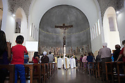 A catholic service taking place in Our Lady Of Peace church, at Missao Paz, São Paulo, Brazil.<br /> <br /> Missao Paz provides advice and support on employment, health, family, community and education. They also have residential quarters where people can stay when they have no where else. <br /> <br /> Their mission is to welcome, understand, integrate and celebrate the lives of immigrants and refugees, dreaming of a universal citizenship.
