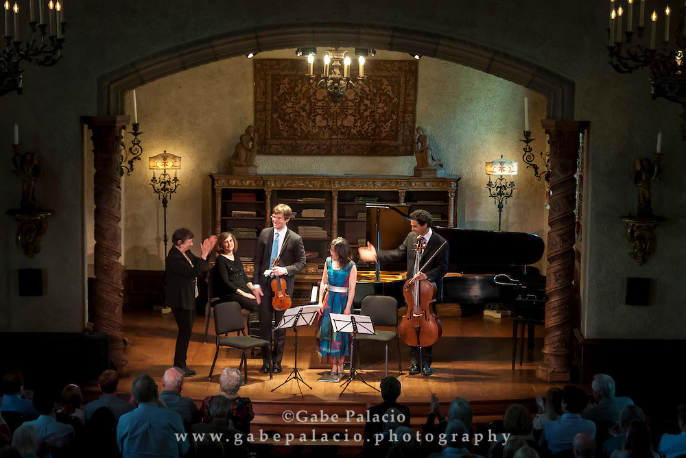 Composer Joan Tower with The Horszowski Trio, consisting of Jesse Mills, Raman Ramakrishnan, and Rieko Aizawa, in the Music Room of the Rosen House at Caramoor in Katonah New York on April 19, 2015. <br /> (photo by Gabe Palacio)