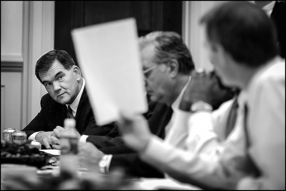 Homeland Security Sec. Designate Tom Ridge looks at a diagram of all the government agencies he must coordinate with in order to do his job during a meeting with Speaker of the House Dennis Hastert and key House Republicans.  10/16/01..©PF BENTLEY/PFPIX.com