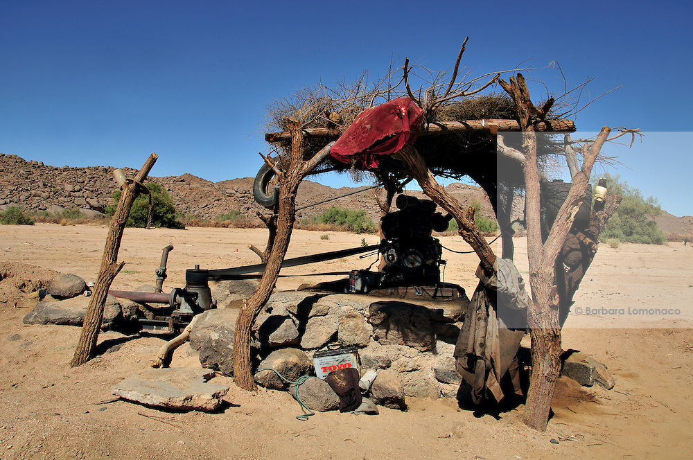 Water well in the desert outside Tamanrasset working through a pump and a car battery.
