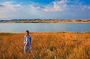 Boy and South Saskatchewan River at sunrise<br />