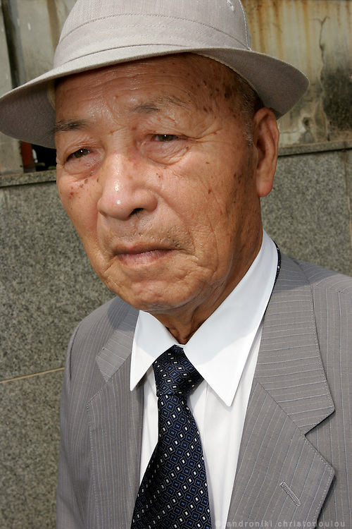 KAZUSHI KANEKO.  Hiroshima A-Bomb survivor and General director of Horoshima Council of A-bomb Sufferers Organizations. Photographed in front of remains of the old Red Cross Hospital.