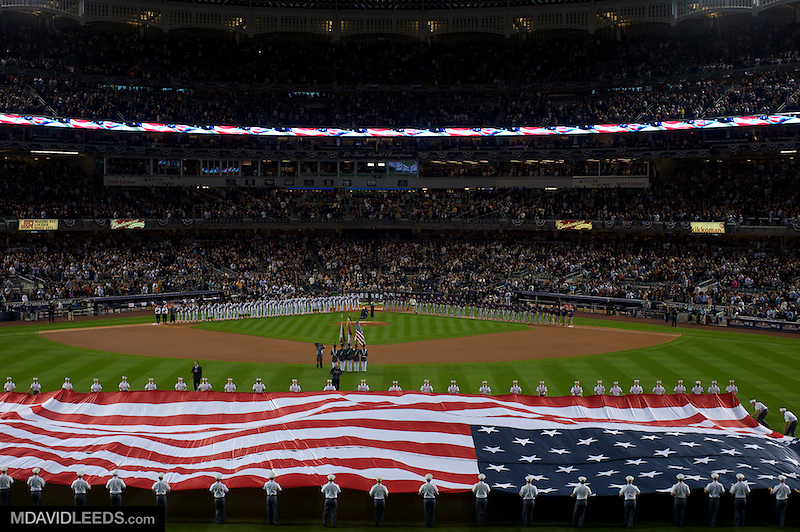 09 Oct 2010 BRONX NY: A color guard presents the US Flag as players line the base paths for the playing of the National Anthem prior to game 3 of the divisional series between the Minnesota Twins and the New York Yankees at Yankee Stadium in the Bronx, NY.<br /> Mandatory Credit: M David Leeds