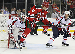 Mar 18; Newark, NJ, USA; The puck hits New Jersey Devils right wing Dainius Zubrus (8) while he sets a screen in front of Washington Capitals goalie Michal Neuvirth (30) during the second period at the Prudential Center.