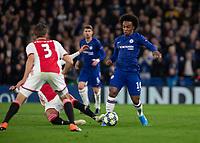 Football - 2019 / 2020 UEFA Champions League - Group H: Chelsea vs. Ajax<br /> <br /> Willian (Chelsea FC) rides the sliding tackle at Stamford Bridge <br /> <br /> COLORSPORT/DANIEL BEARHAM