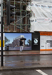 General views of the building site at the intersection on St Paul's Way and Burdett Road in Mile End where bricks fell from a crane seriously injuring a woman on Tuesday March 27th. PICTURED: A man with an umbrella walks past the brick dust covers the pavement at the spot where the woman was injured. London, March 28 2018.