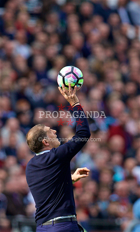 LONDON, ENGLAND - Saturday, April 22, 2017: West Ham United's manager Slaven Bilic catches the ball during the FA Premier League match against Everton at the London Stadium. (Pic by David Rawcliffe/Propaganda)