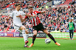 Connor Wickham of Sunderland is challenged by Federico Fernandez of Swansea City - Photo mandatory by-line: Rogan Thomson/JMP - 07966 386802 - 27/08/2014 - SPORT - FOOTBALL - Sunderland, England - Stadium of Light - Sunderland v Swansea City - Barclays Premier League.
