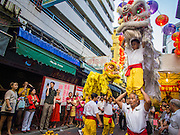 "19 FEBRUARY 2015 - BANGKOK, THAILAND: Lion dancers perform for Chinese New Year in Bangkok. 2015 is the Year of Goat in the Chinese zodiac. The Goat is the eighth sign in Chinese astrology and ""8"" is considered to be a lucky number. It symbolizes wisdom, fortune and prosperity. Ethnic Chinese make up nearly 15% of the Thai population. Chinese New Year (also called Tet or Lunar New Year) is widely celebrated in Thailand, especially in urban areas that have large Chinese populations.    PHOTO BY JACK KURTZ"