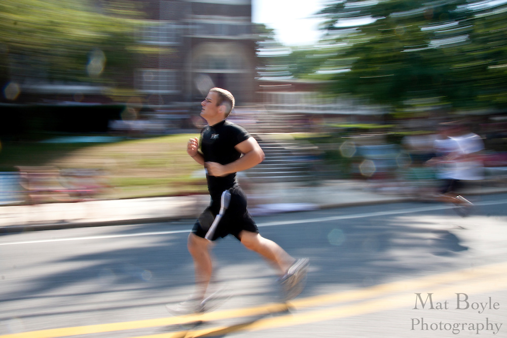 A man runs by a church during the Pitman Freedom 4 Mile race on July 5th 2010.