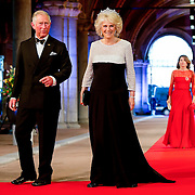 Prince Charles, the Prince of Wales, left, and Camilla, the Duchess of Cornwall, right, arrive for a dinner, at the invitation of Queen Beatrix, with members of the royal family and guests at the Rijksmuseum in Amsterdam, The Netherlands, on Monday night, April 29, 2013. HANDOUT/ROBIN UTRECHT