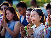 13 APRIL 2018 - BANGKOK, THAILAND:  People pray during a religious observance on the first day of Songkran in Lumpini Park in Bangkok. Songkran is the traditional Thai New Year celebration best known for water fights.    PHOTO BY JACK KURTZ