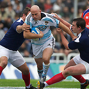 Man of the match Felipe Contepomi, Argentina, (centre) is tackled by Julien Bonaire, France, (right) during the Argentina V France test match at Estadio Jose Amalfitani, Buenos Aires,  Argentina. 26th June 2010. Photo Tim Clayton...
