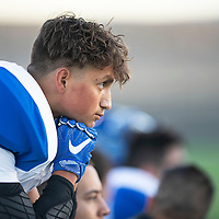 Miguel Romero, 17, a senior for the Questa Wildcats football team watches the field before their game against Newcomb, Friday Sept. 29, 2018 in Newcomb.