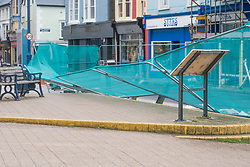 © Licensed to London News Pictures. 21/09/2018. Aberystwyth, UK. Security fencing blown down by the strong winds as Storm Bronagh, the second named storm of the UK winter , increases in intensity with gusts of over 50mph by mid-morning in Aberystwyth .Photo credit: Keith Morris/LNP