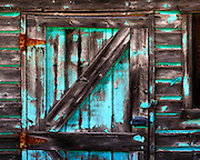 An old weathered barn in northern Utah shows the remnants of aqua-colored paint. Colin Braley