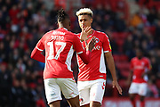 Charlton Athletic midfielder Joe Aribo (17) slapping hands with Charlton Athletic attacker Lyle Taylor (9) during the EFL Sky Bet League 1 match between Charlton Athletic and Rochdale at The Valley, London, England on 4 May 2019.