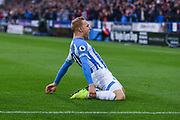 Alex Pritchard of Huddersfield Town (21) scores a goal and celebrates to make the score 1-0 during the Premier League match between Huddersfield Town and West Ham United at the John Smiths Stadium, Huddersfield, England on 10 November 2018.