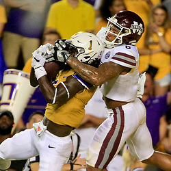 Sep 17, 2016; Baton Rouge, LA, USA;  LSU Tigers defensive back Donte Jackson (1) is unable to hold on to an interception as Mississippi State Bulldogs wide receiver Donald Gray (6) wrestles for the ball during the second half of a game at Tiger Stadium. LSU defeated Mississippi State 23-20. Mandatory Credit: Derick E. Hingle-USA TODAY Sports