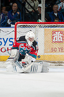KELOWNA, CANADA - OCTOBER 11: Jackson Whistle #1 of Kelowna Rockets keeps his eye on the puck as he defends the net against the Lethbridge Hurricanes on October 11, 2014 at Prospera Place in Kelowna, British Columbia, Canada.   (Photo by Marissa Baecker/Shoot the Breeze)  *** Local Caption *** Jackson Whistle;