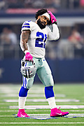 ARLINGTON, TX - OCTOBER 14:  Ezekiel Elliott #21 of the Dallas Cowboys walks to the sidelines in the first half of a game against the Jacksonville Jaguars at AT&T Stadium on October 14, 2018 in Arlington, Texas.  The Cowboys defeated the Jaguars 40-7.  (Photo by Wesley Hitt/Getty Images) *** Local Caption *** Ezekiel Elliott
