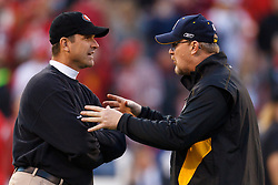 Dec 19, 2011; San Francisco, CA, USA; San Francisco 49ers head coach Jim Harbaugh (left) talks with Pittsburgh Steelers quarterbacks coach Randy Fichtner (right) before the game at Candlestick Park. San Francisco defeated Pittsburgh 20-3. Mandatory Credit: Jason O. Watson-US PRESSWIRE