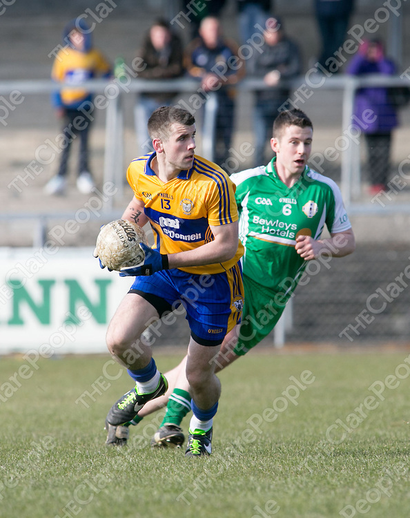 Clare's Mark McCarthy &amp; London's Eamon McConville in action during their Football League Game in Cusack Park Ennis Co. Clare<br /> Pictured Credit Brian Gavin Press 2
