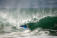 20 June 2006:  Boogie boarder rides a wave during a South swell reaches the famous surf spot in Newport Beach, CA called The Wedge.  Surfers, boogie boarders, body surfers and crowds gather to watch the powerful waves and the waters take shape into unique sets along the jetty in Orange County, California.