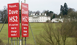 © Licensed to London News Pictures. 27/01/2012. Little Missenden, UK. An anti HS2 (High Speed Rail 2) sign near the village of Little Missenden, Buckinghamshire. The rail route runs through the countryside pictured. Scheduled to be completed by 2033, the new Rail system will have huge effects on the chocolate box English village. Photo credit : Ben Cawthra/LNP