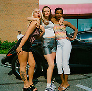Girls from the US posing in a car park tattoo on leg