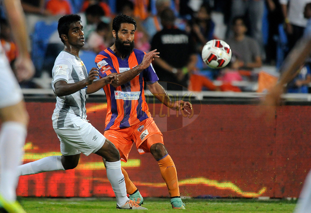 Mehrajuddin Wadoo of FC Pune City and Nallappan Mohanraj of Atletico de Kolkata in action during match 44 of the Hero Indian Super League between FC Pune City and Atletico de Kolkata FC held at the Shree Shiv Chhatrapati Sports Complex Stadium, Pune, India on the 29th November 2014.<br /> <br /> Photo by:  Pal Pillai/ ISL/ SPORTZPICS