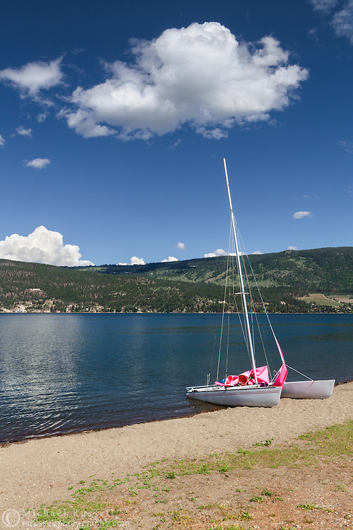 A small sailboat on an Okanagan Lake beach at Fintry Provincial Park in the Thompson Okanagan region of British Columbia, Canada