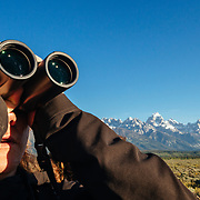 Teten Science Schools tour participants watch a herd of elk forage in the early morning hours. (Dawson) Tetons in the background.