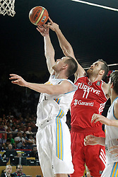 02.09.2014, City Arena, Bilbao, ESP, FIBA WM, Ukraine vs Türkei, im Bild Ukraine's Ihor Zaytsev (l) and Turkey's Oguz Savas // during FIBA Basketball World Cup Spain 2014 match between Ukraine and Turkey at the City Arena in Bilbao, Spain on 2014/09/02. EXPA Pictures © 2014, PhotoCredit: EXPA/ Alterphotos/ Acero<br /> <br /> *****ATTENTION - OUT of ESP, SUI*****