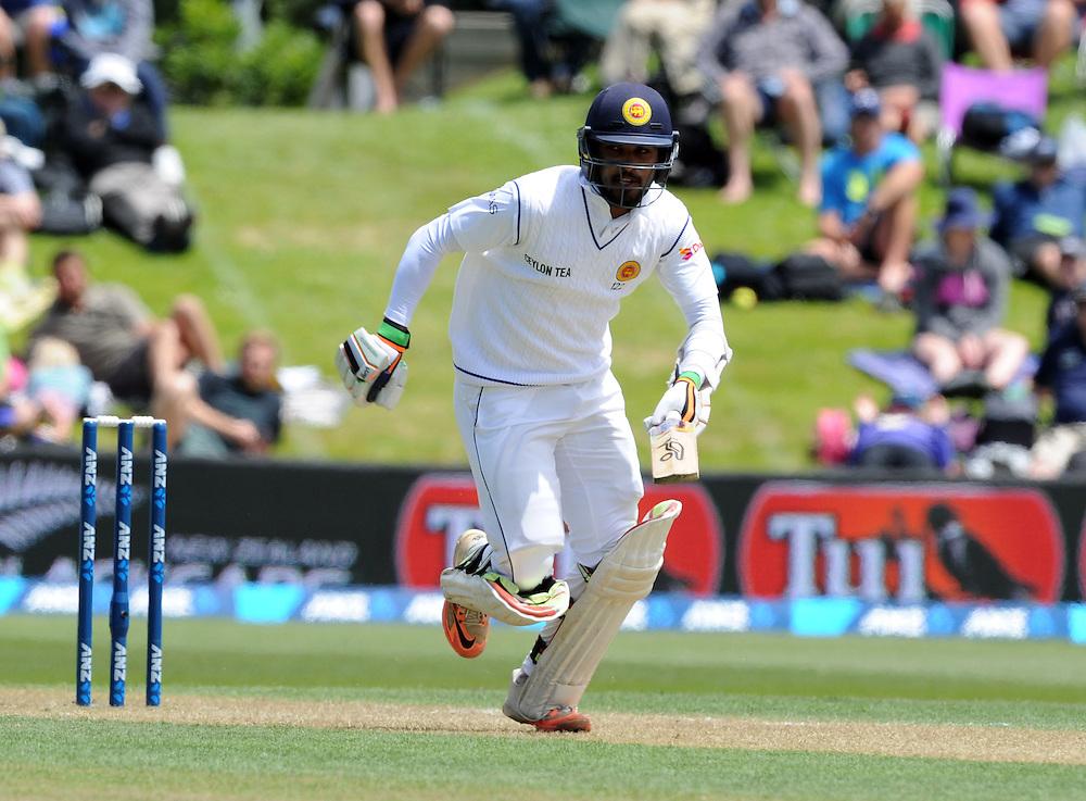 Sri Lanka's Dinesh Chandimal takes a run against New Zealand on day two of the first International Cricket Test, University Cricket Oval, Dunedin, New Zealand, Friday, December 11, 2015. Credit:SNPA / Ross Setford