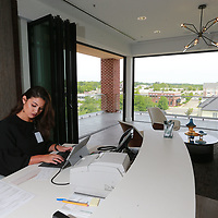 Bank Plus universal banker Marley Whittington works away at her new desk that overlooks the Fairpark District in Tupelo.
