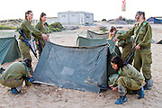 Israeli women in the army pitching a tent, photograph by Debbie Zimelman