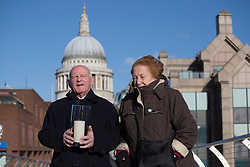 © licensed to London News Pictures. London, UK 27/01/2013. Ben Helfgott (left) and Sabina Milla, Holocaust survivors posing with a candle to mark Holocaust Memorial Day on Millennium Bridge in London. Photo credit: Tolga Akmen/LNP