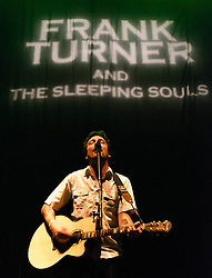 © Licensed to London News Pictures. 20/12/2012. London, UK.   Frank Turner of Frank Turner and the Sleeping Soults performing live at O2 Arena, supporting headliner The Pogues.   Frank Turner is an English folk/punk singer-songwriter from Meonstoke, Winchester.  Photo credit : Richard Isaac/LNP