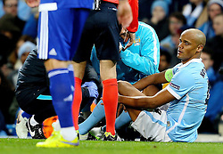 Vincent Kompany of Manchester City picks up an injury - Mandatory byline: Matt McNulty/JMP - 15/03/2016 - FOOTBALL - Etihad Stadium - Manchester, England - Manchester City v Dynamo Kyiv - Champions League - Round of 16