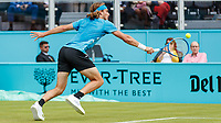 Tennis - 2019 Queen's Club Fever-Tree Championships - Day Three, Wednesday<br /> <br /> Men's Singles, First Round: Stefanos Tsitsipas (GRC) Vs. Kyle Edmund (GBR)<br /> <br /> Stefanos Tsitsipas (GRC) stretches to reach the serve on Centre Court.<br />  <br /> COLORSPORT/DANIEL BEARHAM