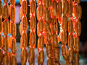 31 DECEMBER 2015 - BANGKOK, THAILAND: Thai sausages for sale in Bang Chak Market. The market is supposed to close permanently on Dec 31, 2015. The Bang Chak Market serves the community around Sois 91-97 on Sukhumvit Road in the Bangkok suburbs. About half of the market has been torn down. Bangkok city authorities put up notices in late November that the market would be closed by January 1, 2016 and redevelopment would start shortly after that. Market vendors said condominiums are being built on the land.          PHOTO BY JACK KURTZ