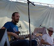 Guitarist and drummer backing up Tom Walbank during Walbank's concert at Fiesta en el Barrio Viejo 2010, Tucson, Arizona.